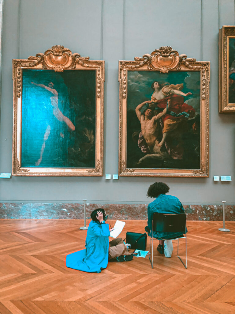 Two women sitting down, copying painting Louvre museum